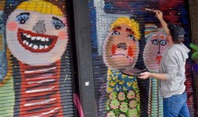 Contemplar a arte urbana na Av. 18 de Julho